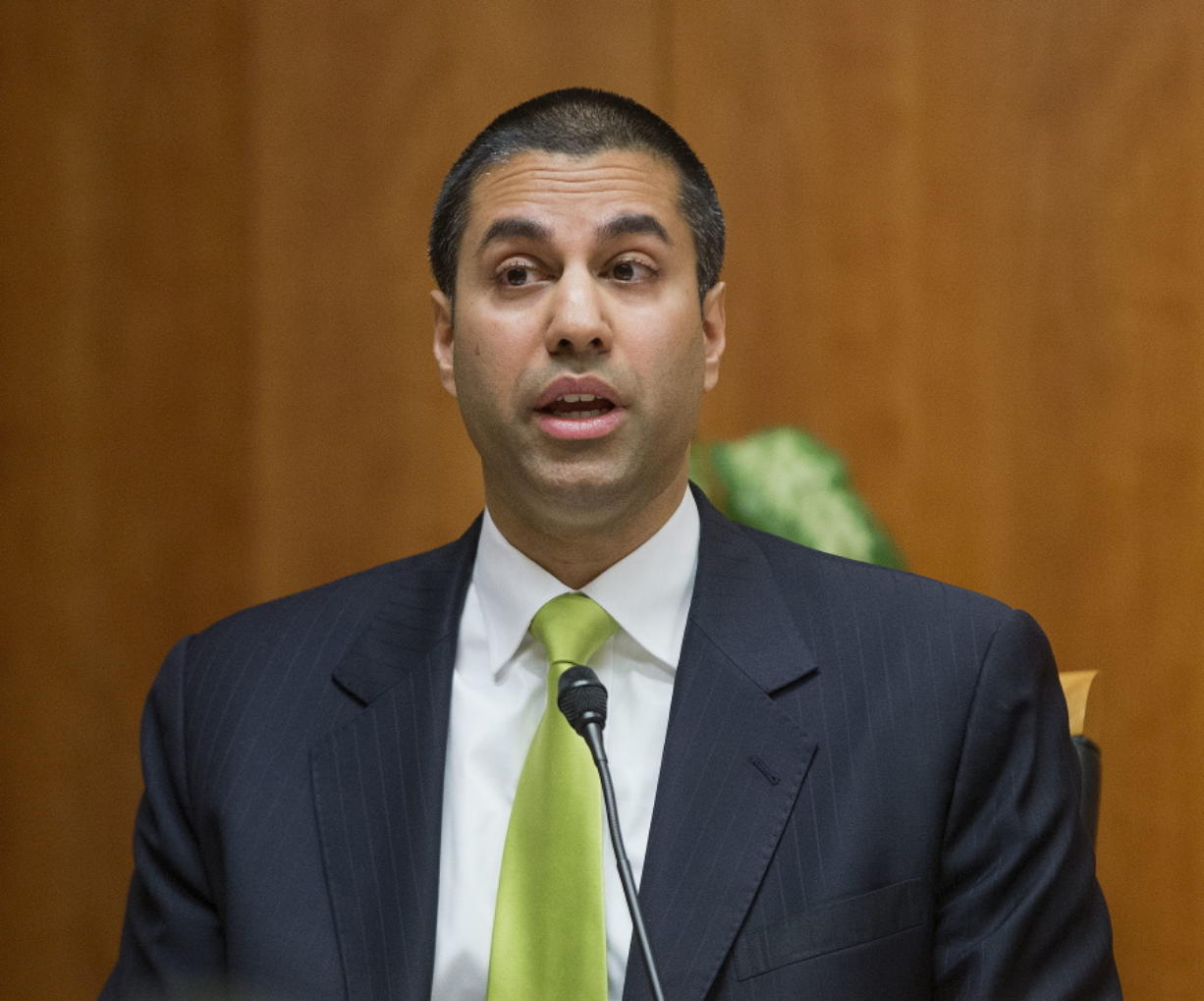 """Federal Communication Commission Commissioner Ajit Pai speaks in 2015 during an open hearing and vote on """"Net Neutrality"""" in Washington. (Pablo Martinez Monsivais/Associated Press)"""
