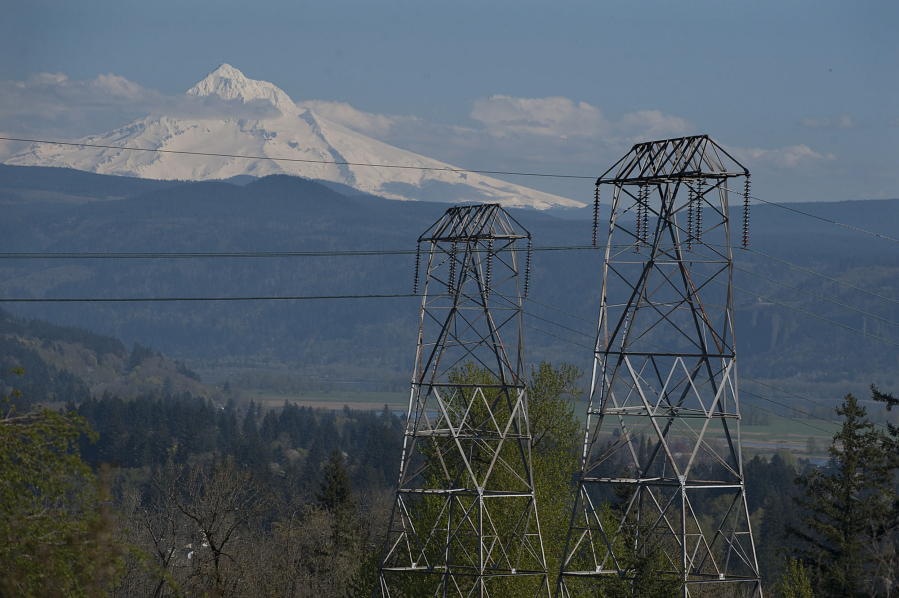 High-voltage power lines are seen in this view looking east from Oak Creek Park with Mount Hood in the background April 1, 2016, in Camas.