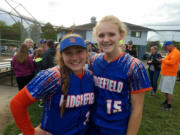 Mia Tomillo and Kaia Oliver of Ridgefield softball team.