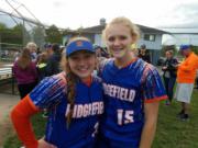 Mia Tomillo and Kaia Oliver of Ridgefield softball team.