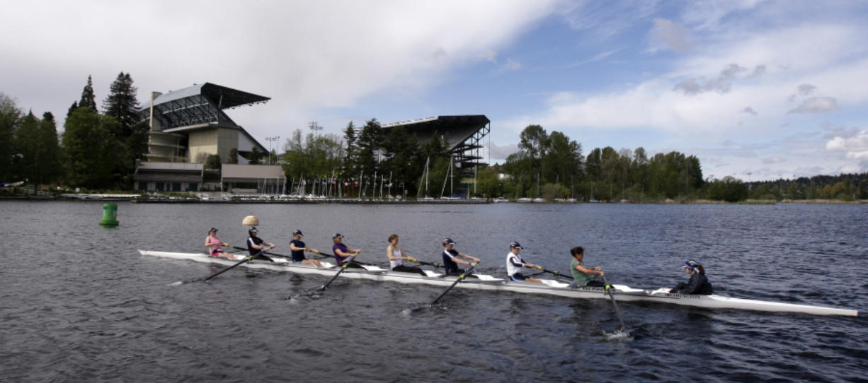 An 8-person rowing team practices on Lake Washington before the Windermere Cup in Seattle. The University of Washington rowing team has a roster full of athletes who learned to row in college, including Columbia River graduate Katelyn Costanza. (Elaine Thompson/The Associated Press)