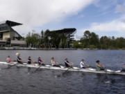 An 8-person rowing team practices on Lake Washington before the Windermere Cup in Seattle. The University of Washington rowing team has a roster full of athletes who learned to row in college, including Columbia River graduate Katelyn Costanza.