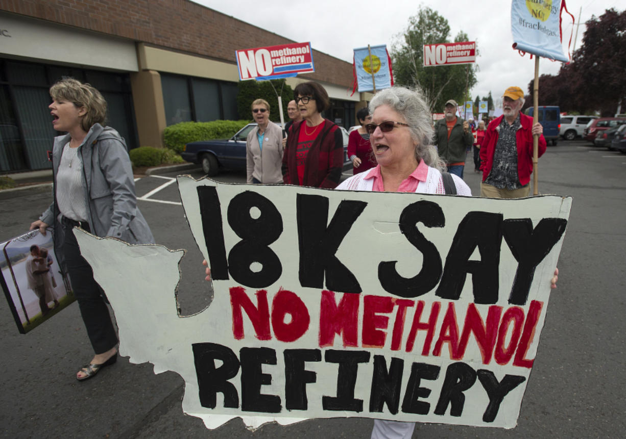Longview resident Diane Dick, center, walks in a crowd of demonstrators to toward the Washington Department of Ecology's office in Orchards. The crowd opposed the NW Innovation Works methanol refinery proposed for Kalama. If approved, it would be the largest of its kind in the world.