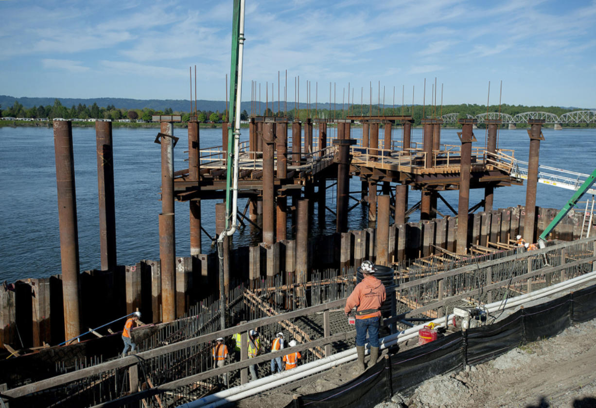 Workers pour concrete for the new Grant Street Pier at the Waterfront Vancouver on Thursday morning. The pier will be supported by cables and is expected to open next spring.