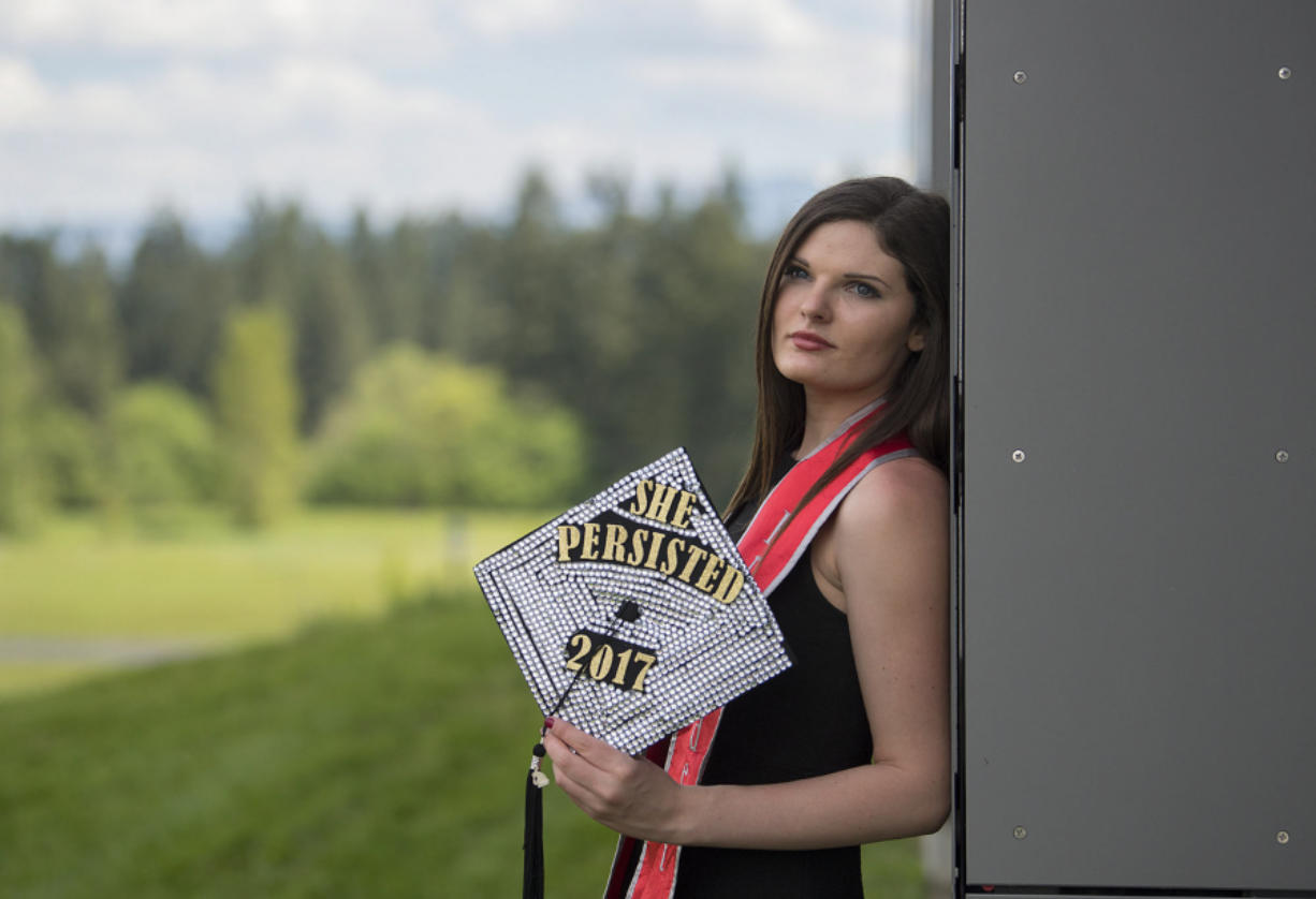 Skye Troy, 22, will graduate with a bachelor's in public affairs from Washington State University Vancouver today. Troy, pictured on campus Thursday, overcame drug addiction and poverty as a child in Oklahoma to receive her degree.