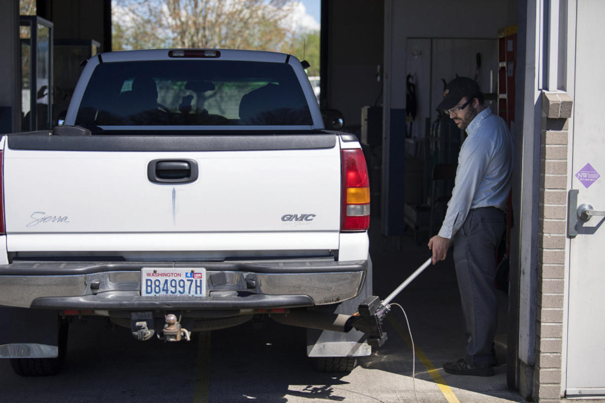 Gabriel Engel tests the emissions of a diesel truck at the Washington State Emission Inspection Station in Vancouver. The Salmon Creek site is scheduled to close in early June. All vehicle smog testing will be done in east Vancouver.
