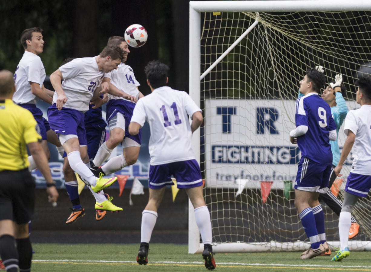 Columbia Riverís Ryan Connop (23), heads the ball into the goal in what was initially thought to be the fourth goal for Columbia River during overtime in the first round of the 2A state playoffs against Highline at the Kiggins Bowl in Vancouver, Tuesday May 16, 2017.