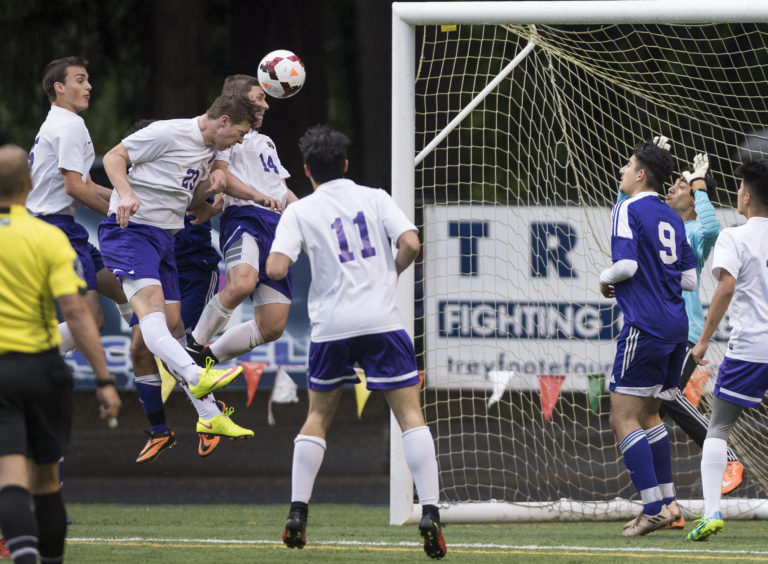 Columbia River's Ryan Connop (23), heads the ball into the goal in what was initially thought to be the fourth goal for Columbia River during overtime in the first round of the 2A state playoffs against Highline at the Kiggins Bowl in Vancouver, Tuesday May 16, 2017.