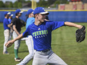 Mountain View High School student Hayden Minich pitches to a teammate during practice at Mountain View High School, Thursday May 18, 2017.