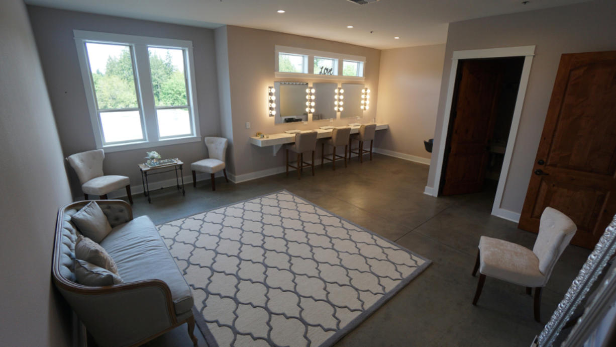 With a dedicated bathroom, a salon-style shampoo bowl, an ample and well-lit make-up counter and plenty of room for seating, visiting and changing, it's clear that a woman's touch went into the 400 square-foot bride's room.