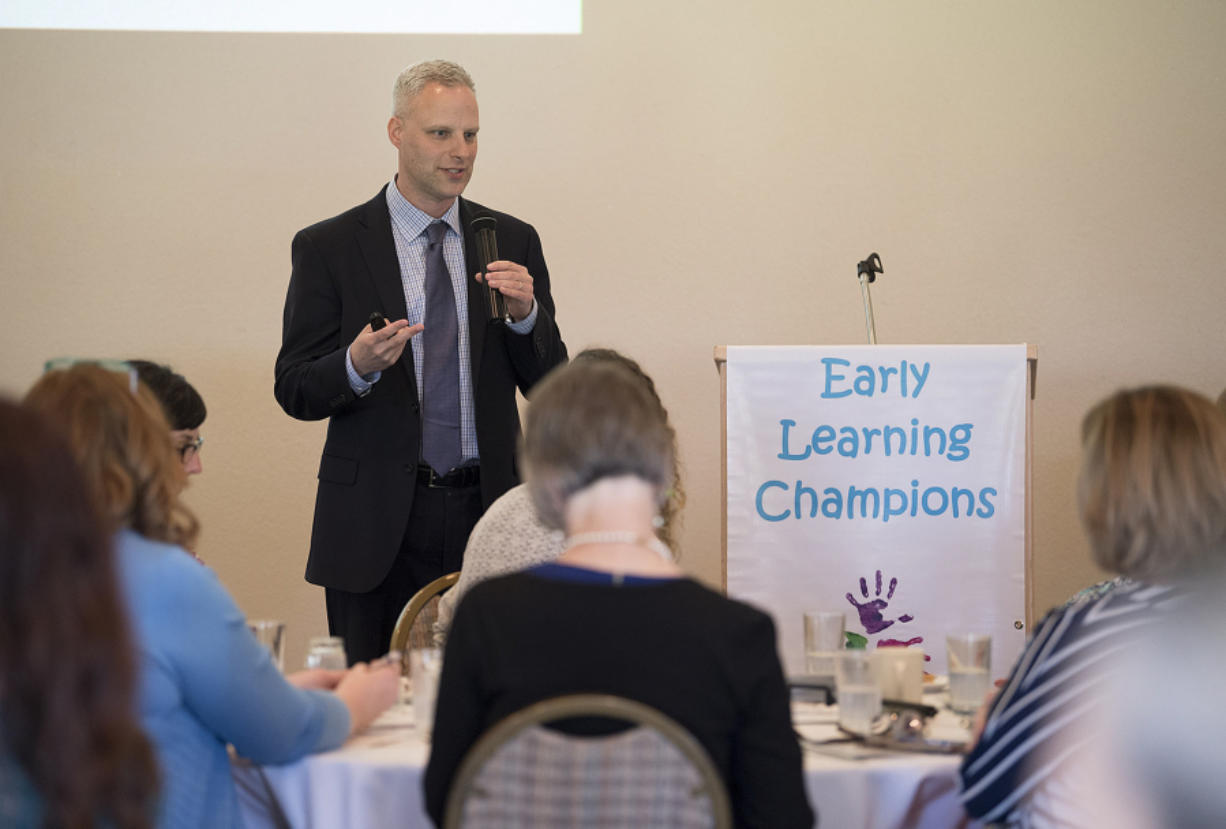 Joel Ryan, executive director of Washington State Association of Head Start and ECEAP, speaks to the crowd during the sixth annual Early Learning Champions Awards Luncheon at Club Green Meadows on Wednesday afternoon. (Amanda Cowan/The Columbian)