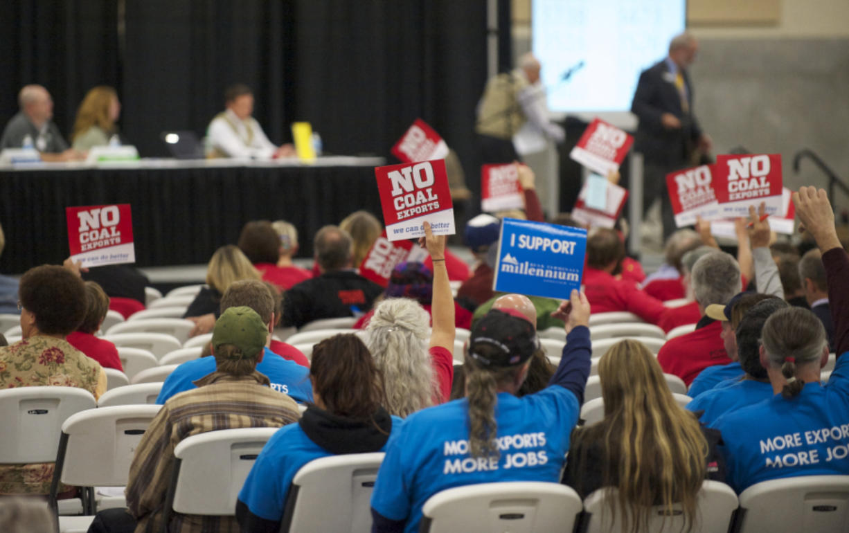 Supporters on both sides of the coal export issue attend a Millennium Bulk Terminals Longview Environmental Impact Statement Scoping meeting at the Clark County Fairgrounds Event Center in 2013. The Columbian Files