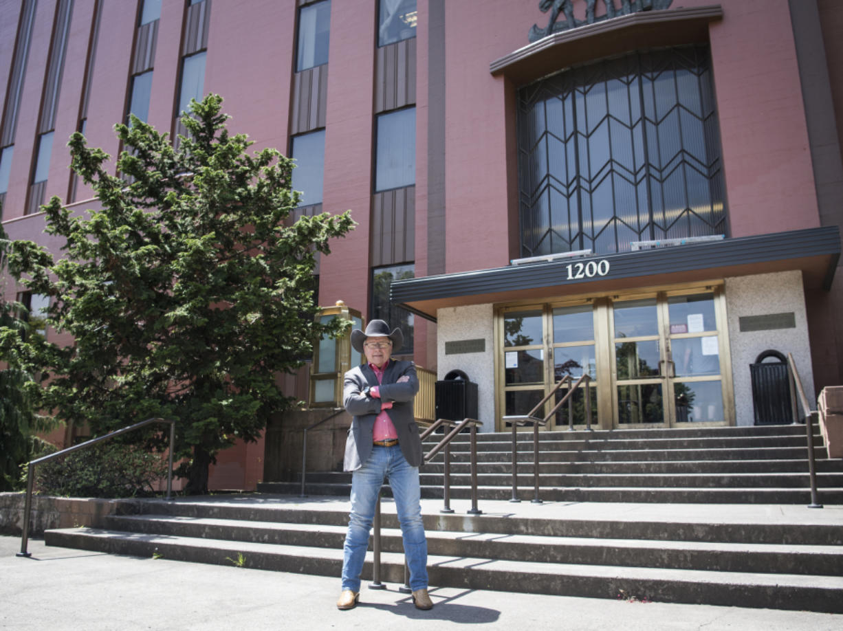 Former Clark County Auditor Ron Dotzauer poses on the steps of the courthouse where he once worked. He's brought his career full circle, opening a branch of his Seattle-based Strategies 360 firm in Vancouver.