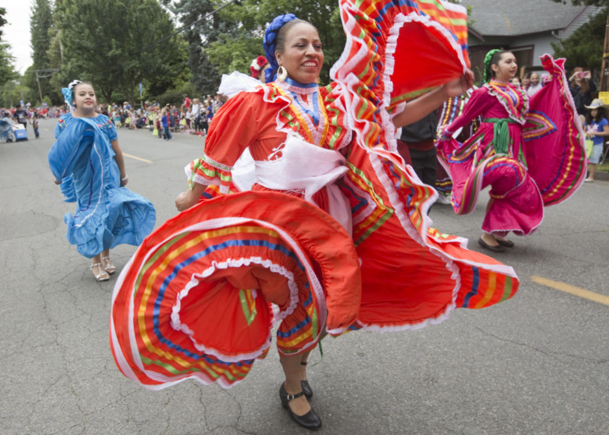 Dancers from the Mexican restaurant El Rancho Viejo take part in the Fourth of July Parade through Ridgefield in 2016.