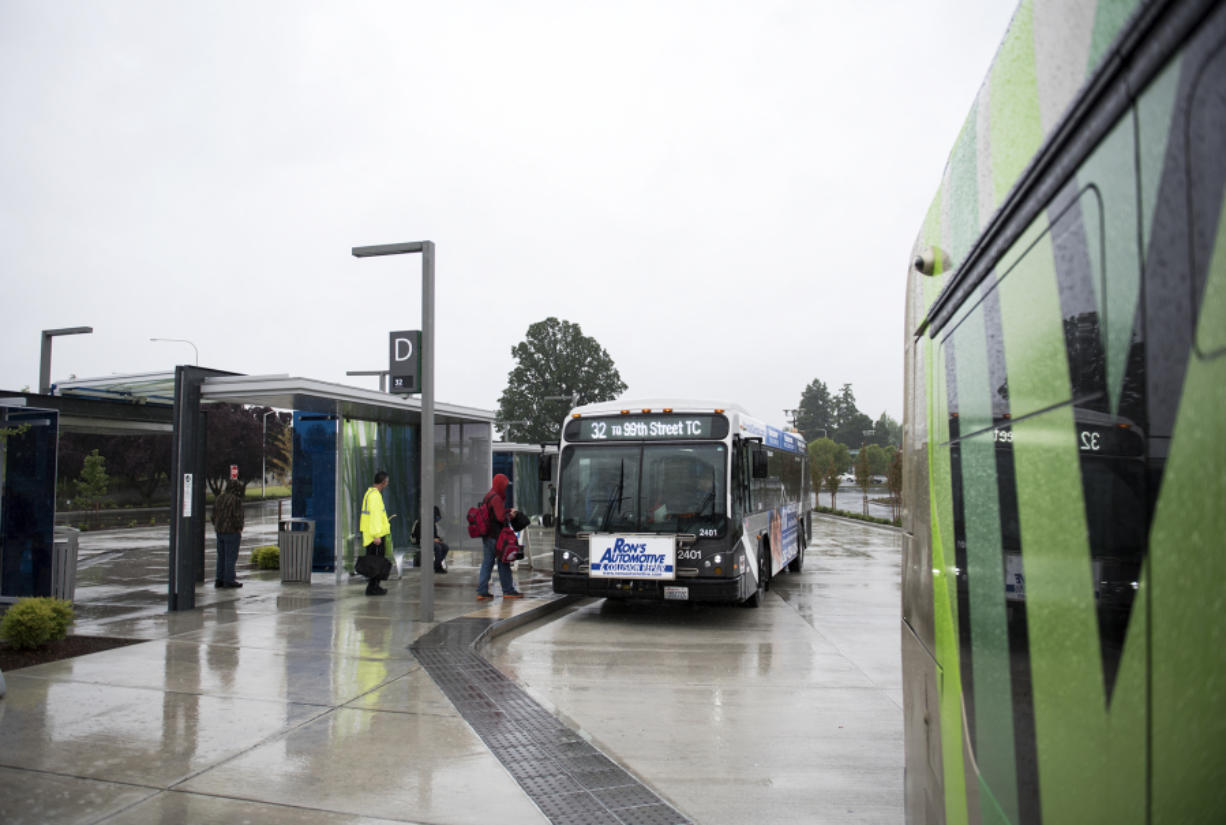 Passengers board a bus the Southside Vancouver Mall Transit Center on Thursday afternoon. The station serves The Vine as well as several other fixed routes including the 32, 7, 72, 73, 74, 78 and 80. (Alisha Jucevic/The Columbian)