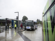 Passengers board a bus the Southside Vancouver Mall Transit Center on Thursday afternoon. The station serves The Vine as well as several other fixed routes including the 32, 7, 72, 73, 74, 78 and 80.