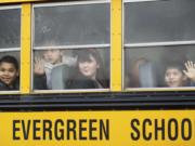 Third grade students from Crestline Elementary School get a first look at Riverview Elementary School through foggy windows of a school bus Thursday February 7, 2013 in Vancouver, Washington. Riverview Elementary welcomed 93 Crestline third-graders, teachers and administrators after their school burned down.