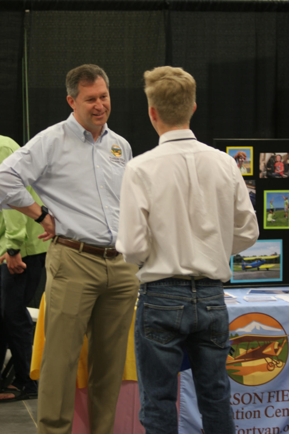 Ridgefield: A representative from the Pearson Field Education Center talks to a student at a Youth Employment Summit at the Clark County Event Center at the Fairgrounds on May 23, where teenagers learned about summer employment options, practiced mock interviews and applied for jobs.