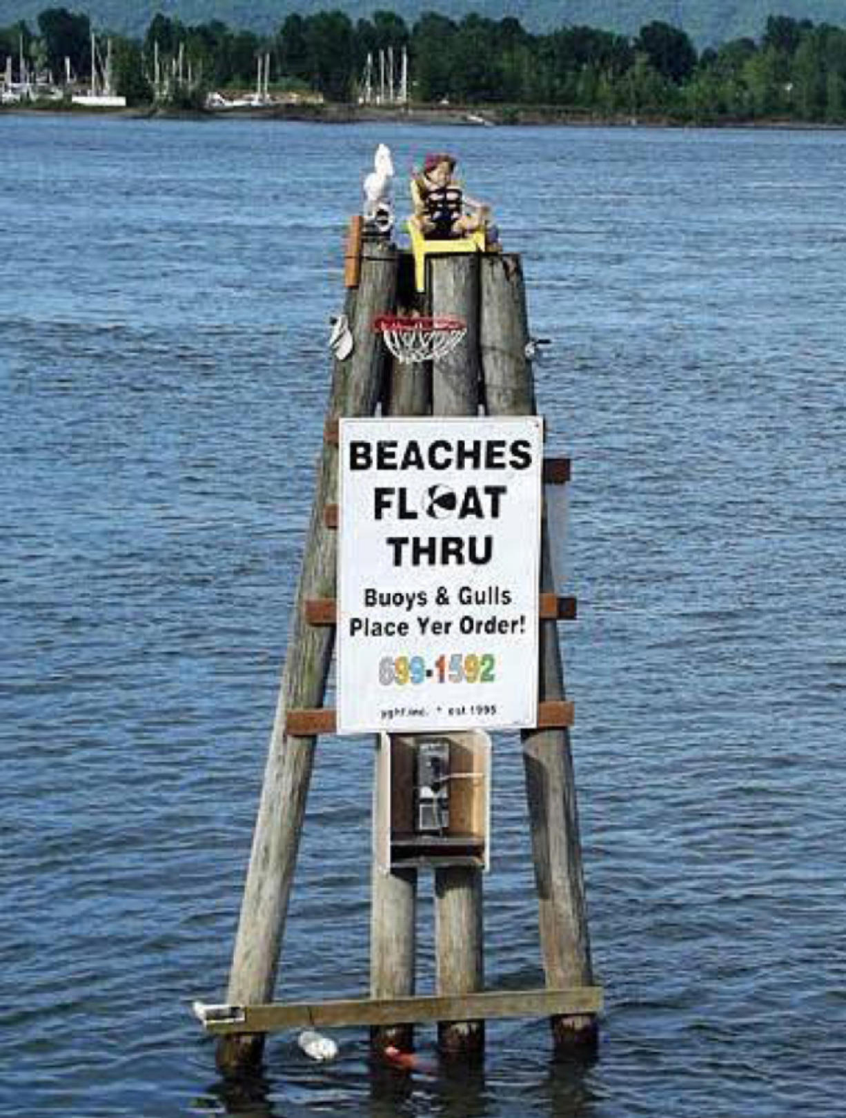 The sign for Beaches Restaurant and Lounge floated away sometime last Wednesday, its owner said. The restaurant is offering dinner for 20 to the person who retrieves it.