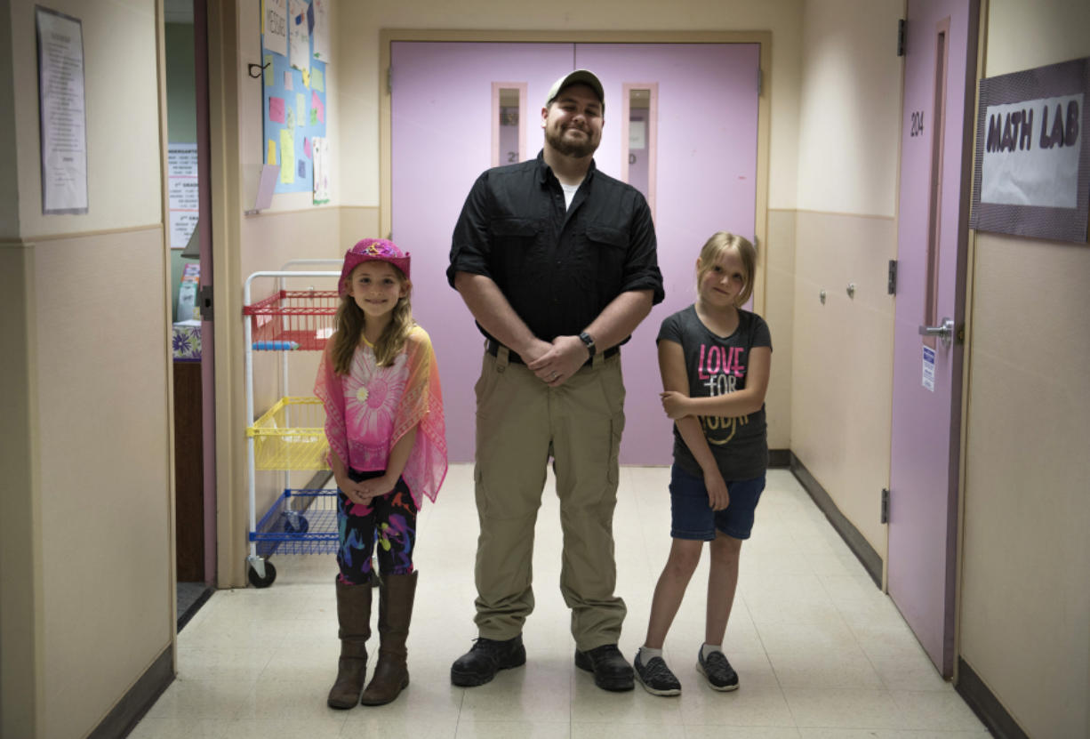 Hockinson Heights Elementary School's Makena Nelson, from left, Tucker Cendana and Kaylin Oliver teamed up to help a choking student during lunch last month.