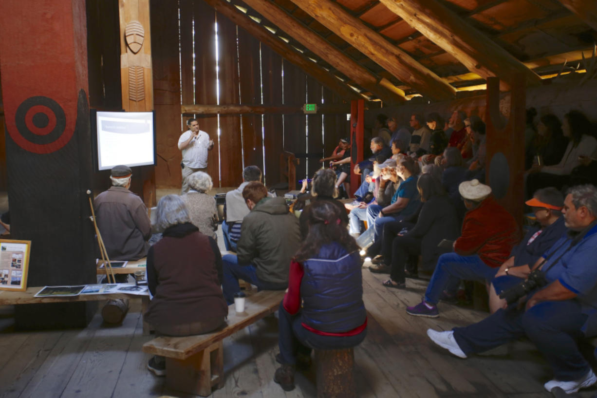 Anthropologist David Lewis talks about the colonization of Native American history by white American culture at the Cathlapotle Plankhouse at the Ridgefield National Wildlife Refuge on Sunday.