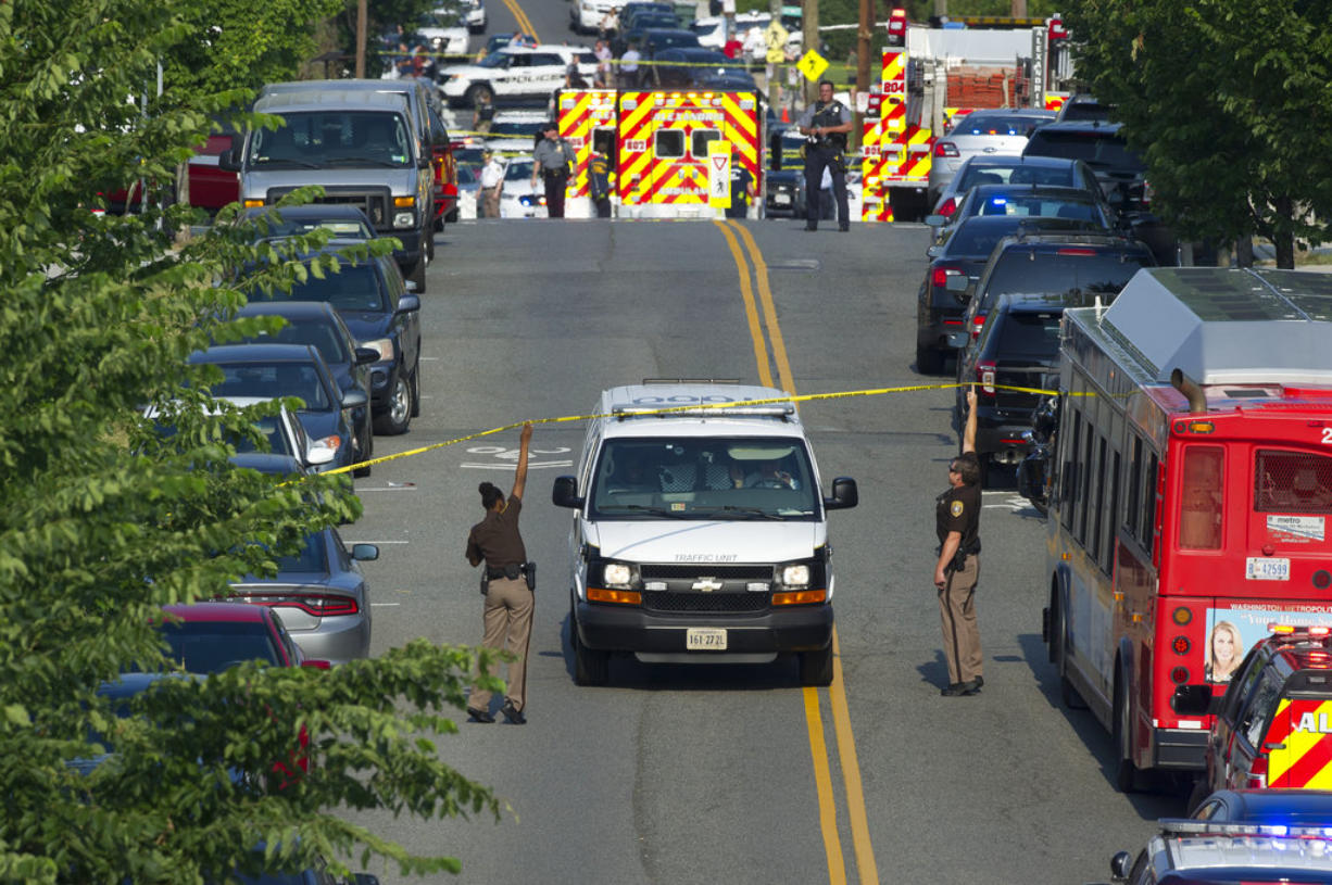 Police and emergency personnel are seen near the scene where House Majority Whip Steve Scalise of La. was shot during a Congressional baseball practice in Alexandria, Va., Wednesday, June 14, 2017.