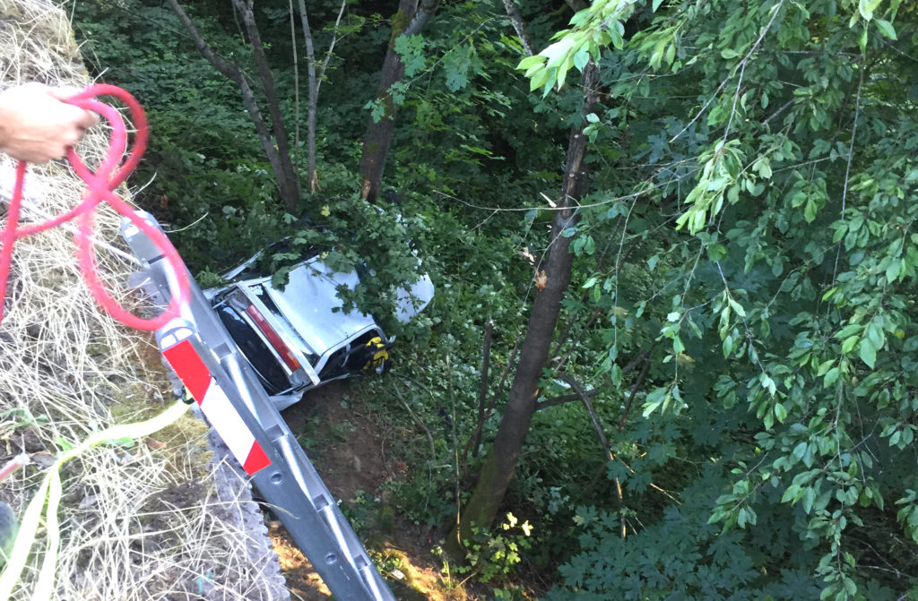 Firefighters worked for about a half an hour to reach an injured driver who went down an embankment and was ejected in a crash on Interstate 5 Thursday evening.