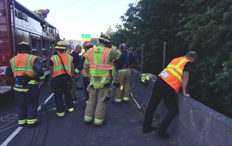 Firefighters worked for about a half an hour to reach an injured driver who went down an embankment and was ejected in a crash on Interstate 5 Thursday evening. (Clark County Fire District 6)
