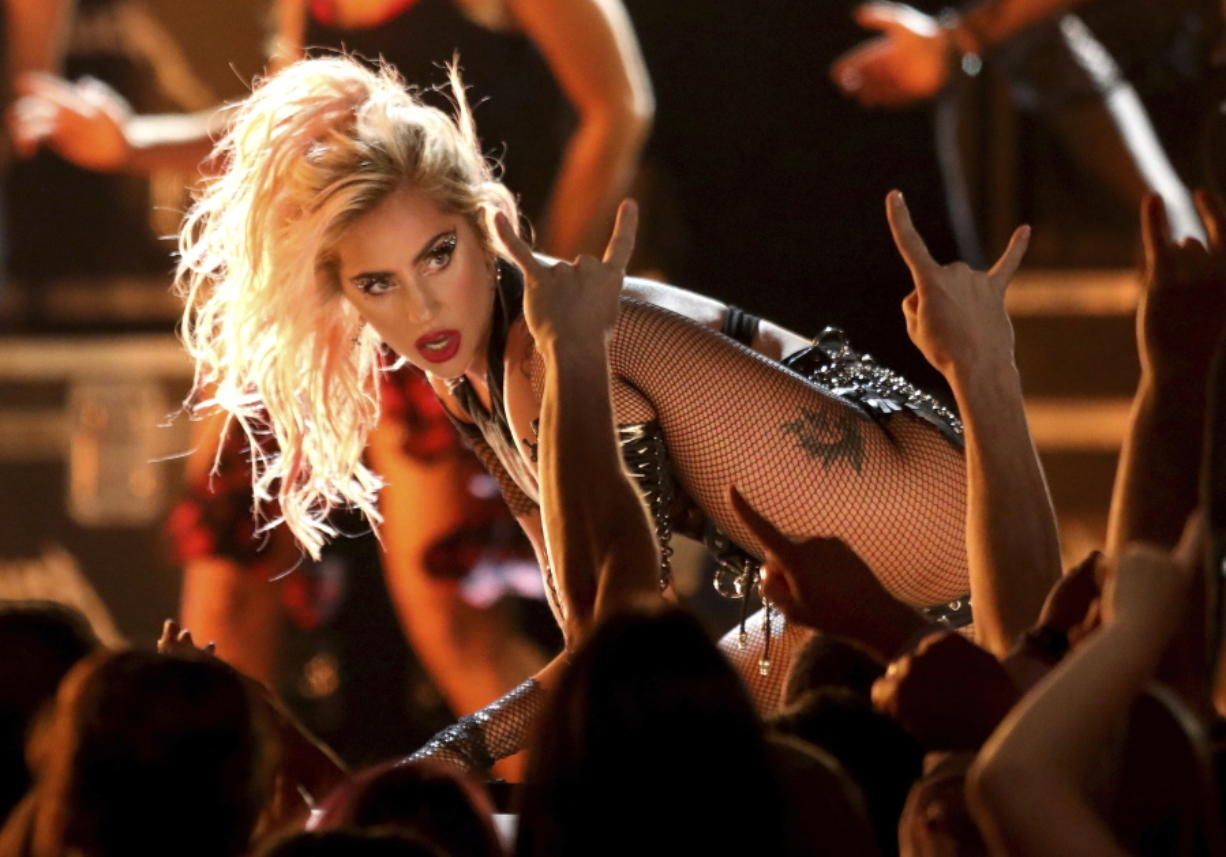 "Lady Gaga performs ""Moth Into Flame"" Feb. 12 at the 59th annual Grammy Awards in Los Angeles. Whether it's at a bar or baseball park, Lady Gaga said she's going to give every performance her all. Associated Press files"
