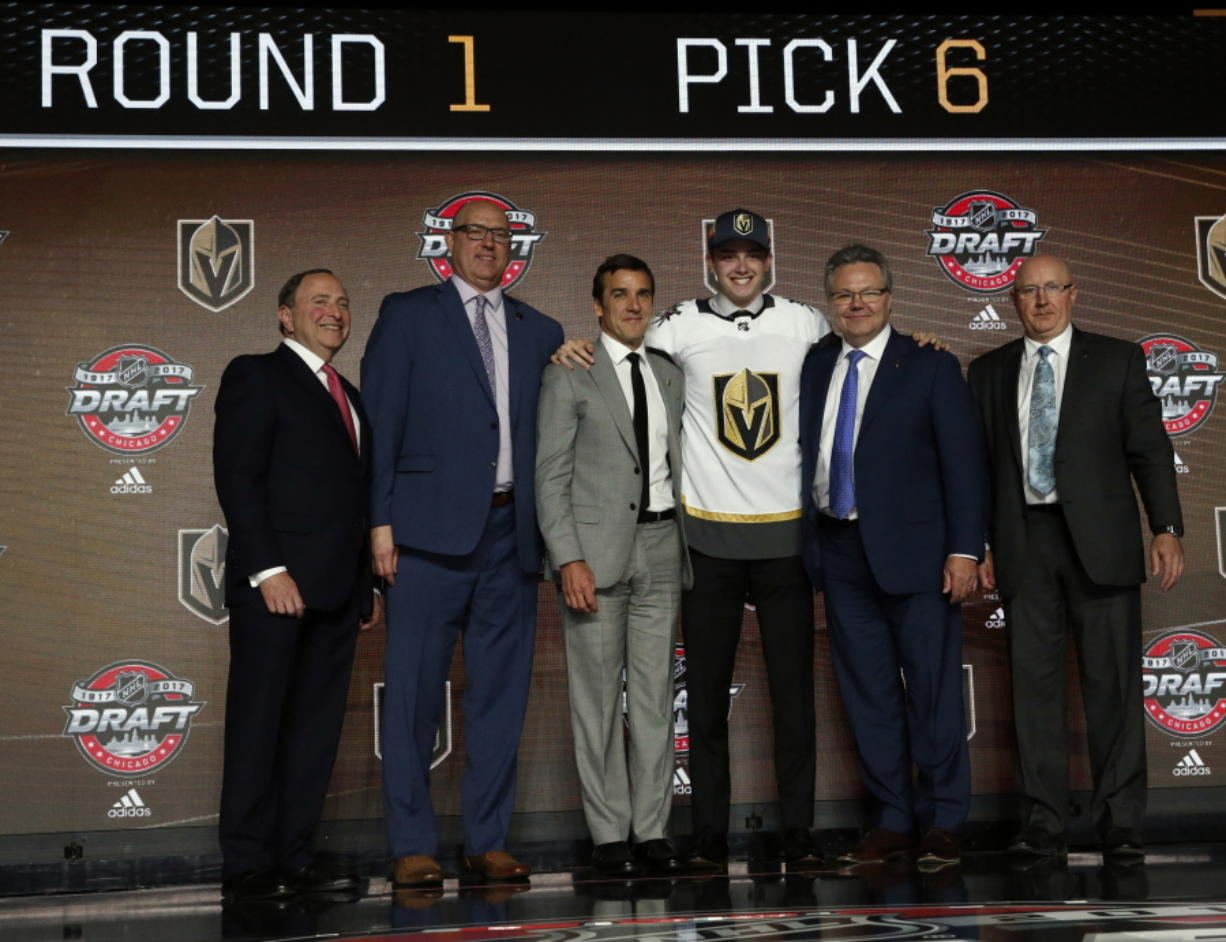 Cody Glass, third from right, wears a Vegas Golden Knights jersey after being selected by the team in the first round of the NHL hockey draft, Friday, June 23, 2017, in Chicago. (AP Photo/Nam Y.