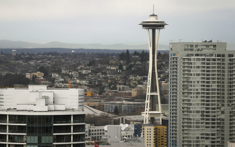 """FILE--In this Feb. 17, 2016, file photo, the Space Needle is shown as viewed from a building in downtown Seattle. A new lawsuit is challenging Seattle's first-in-the-nation voucher system for publicly financing political campaigns. The libertarian-leaning law firm Pacific Legal Foundation is suing the city over its new """"democracy voucher"""" program, which was passed by voters in 2015 and is being used for the first time in this year's City Council races. (AP Photo/Ted S."""