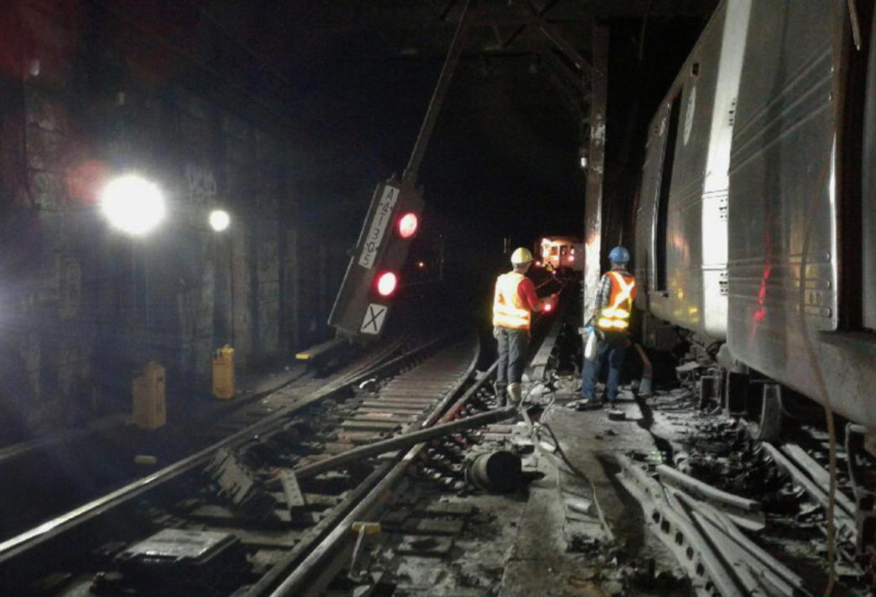 In this photo provided by the Transport Workers Union, Local 100, workers from the New York Metropolitan Transportation Authority respond to the scene of a subway derailment, Tuesday, June 27, 2017, in New York. A subway train derailed near a station in the Harlem neighborhood of New York, frightening passengers and resulting in minor injuries as hundreds of people were evacuated from trains along the subway line. (Transport Workers Union, Local 100 via AP)