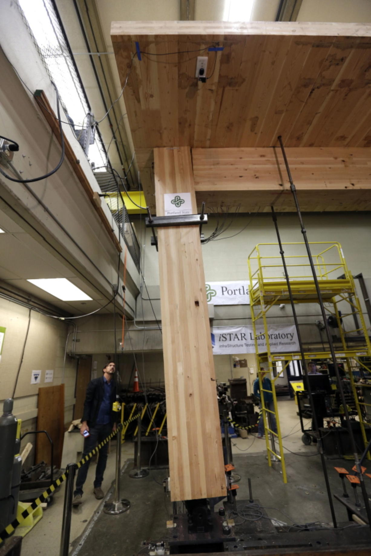 Lever Architecture founder Thomas Robinson looks over a strength test on cross-laminated timber beams, or CLT, at Portland State University in Portland.