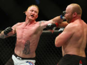 At nearly 37 years old, Ed Herman, left, knows the end of his competitive days in mixed martial arts is approaching. The Battle Ground fighter will rely on toughness and grit in Friday's UFC bout against CB Dollaway in Las Vegas.