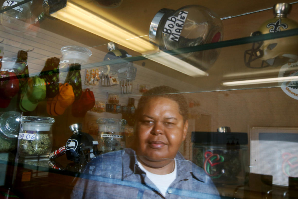 Donnie Anderson is one of the owners of Medex, a medical marijuana dispensary in South L.A. Anderson is among marijuana retailers who must navigate a confusing, complex system for the financial side of their business.