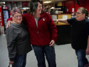 Judy Boepple, from left, her daughter and City Administrator Dawn Marquardt chat with Nana Lil's Cafe owner Lillian Hoffman. Hoffman started the popular diner right before the oil boom took off.