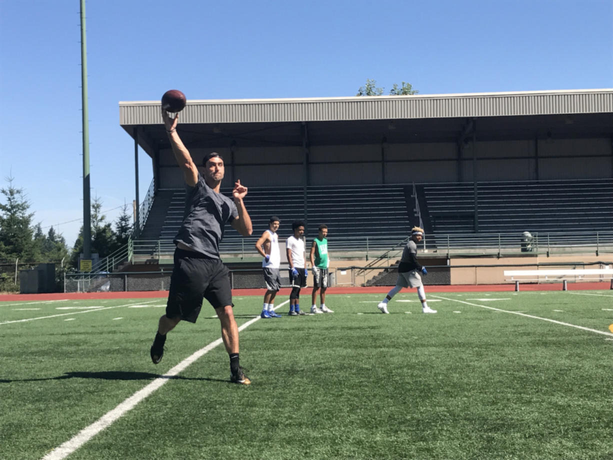 New Orleans Saints quarterback Garrett Grayson throws to Mountain View High School receivers during practice Monday at McKenzie Stadium in Vancouver. Grayson, from Vancouver, is about to enter his third NFL season. (Meg Wochnick/The Columbian)