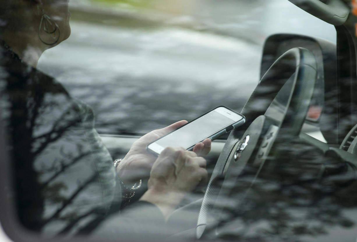 A motorist is stopped for talking on a cellphone in Vancouver during an April emphasis patrol.