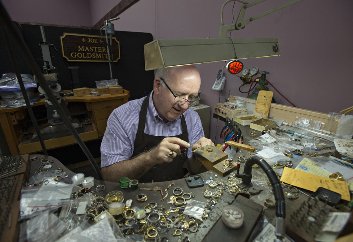 Joe Lanning, co-owner of My Jeweler, works on a ring in his downtown Vancouver shop. The 70-year-old hopes to work for years to come and is part of a growing share of older people in the workforce.