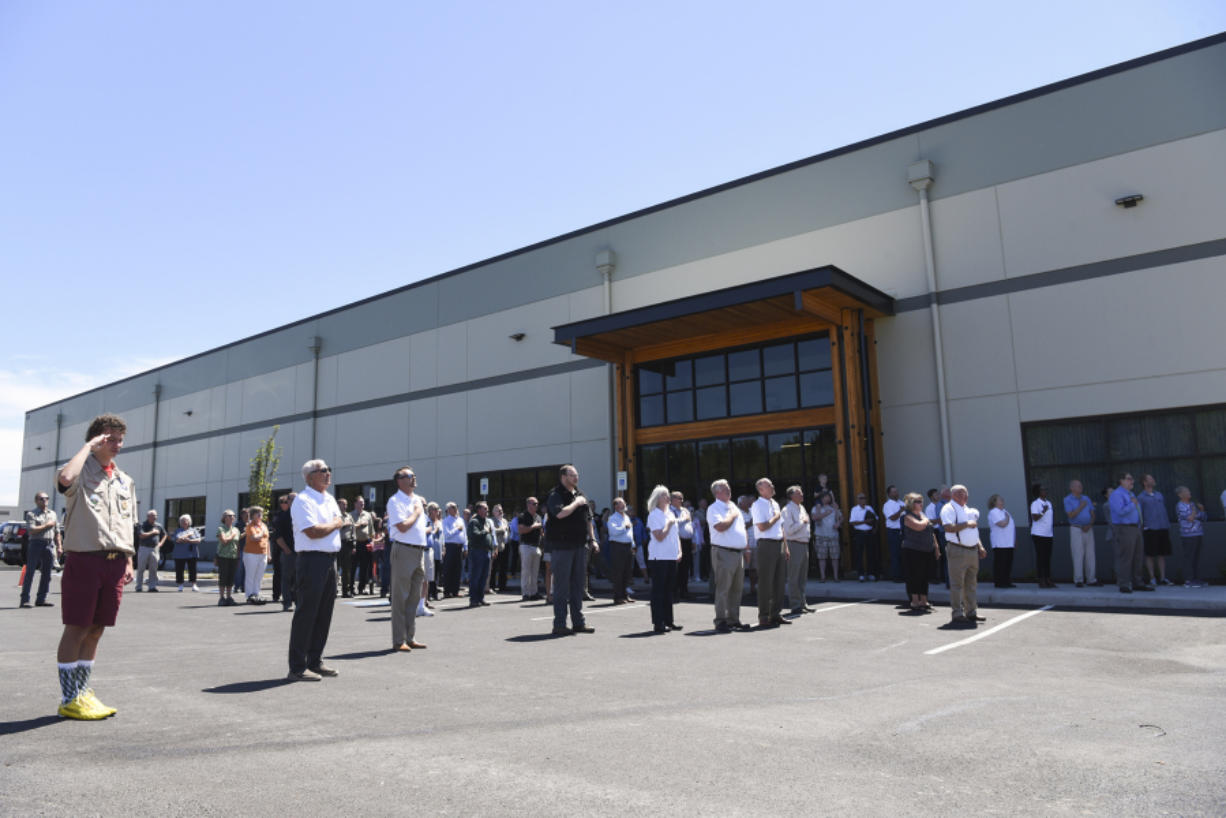 Employees from the Port of Ridgefield and state Fish and Wildlife's Region 5 office join community members in the Pledge of Allegiance during a ceremony Wednesday for the opening of the new regional Fish and Wildlife headquarters in Ridgefield. (Ariane Kunze/The Columbian)