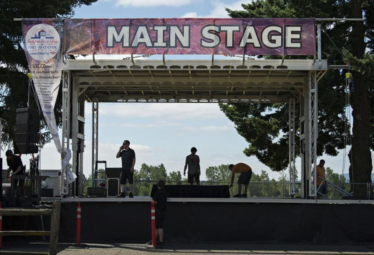 Workers from Wager Audio set up the main stage Monday morning along East Fifth Street in preparation for Tuesday's Fourth of July festivities at Fort Vancouver National Historic Site.