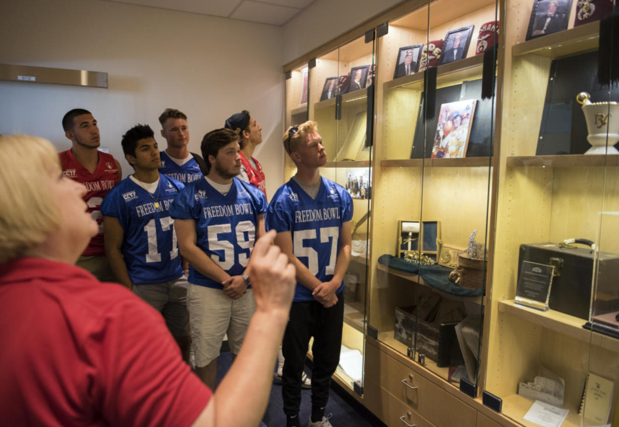 Freedom Bowl Classic football players tour the historical display room Shriners Hospital in Portland Wednesday, July 5, 2017. (Alisha Jucevic/The Columbian)