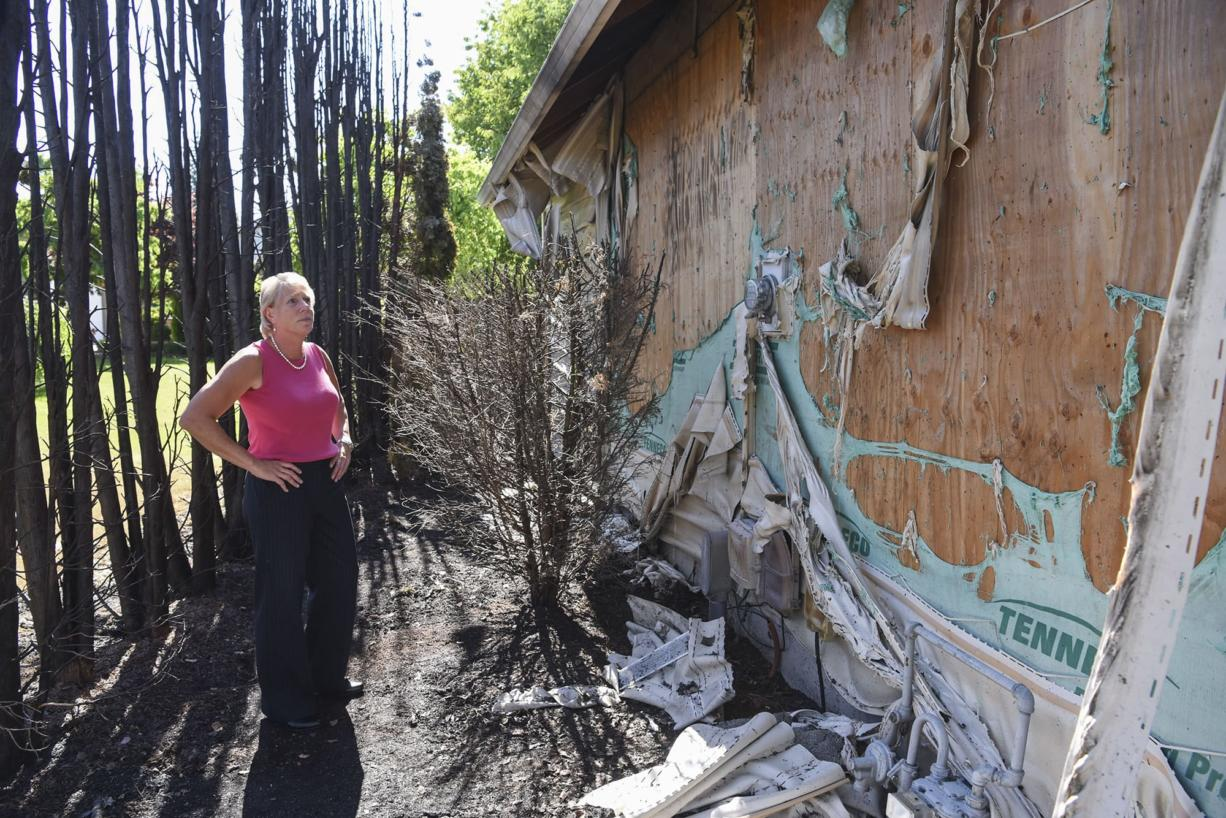 Clark County Councilor Julie Olson has had better Fourth of July holidays. Olson gazes at the damage left by a fire that broke out early morning July 5. She and the fire marshal suspect a smoldering firework was to blame.