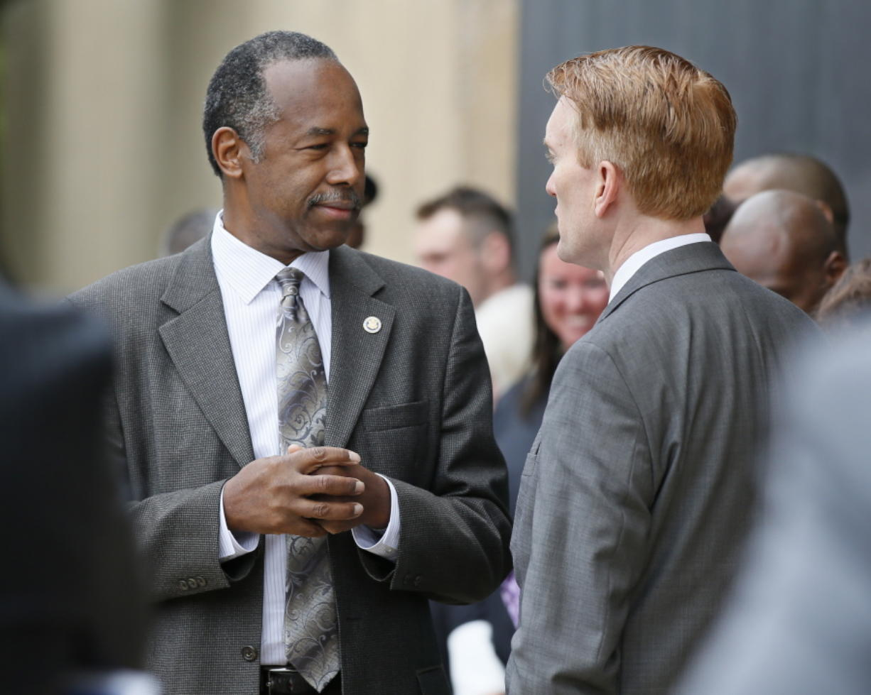 """Housing and Urban Development Secretary Ben Carson, left, talks April 19 with Sen. James Lankford, R-Okla. in Oklahoma City, Oklahoma. Carson is pledging to """"work toward a time when no family is without a home,"""" even as the Trump administration seeks sharp budget cuts that critics say would lead to more people living on the streets. (AP Photo/Sue Ogrocki)"""