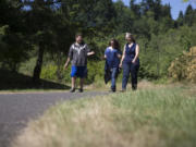 Amy Bounds' husband, Jeff, uses a wheelchair, so she's on the lookout for places they can go on family outings. Bounds, right, and two of her children, Rebecca, 15, and Ian, 17, checked out the Salmon Creek Greenway and Trail in Vancouver on July 1. Randy L.