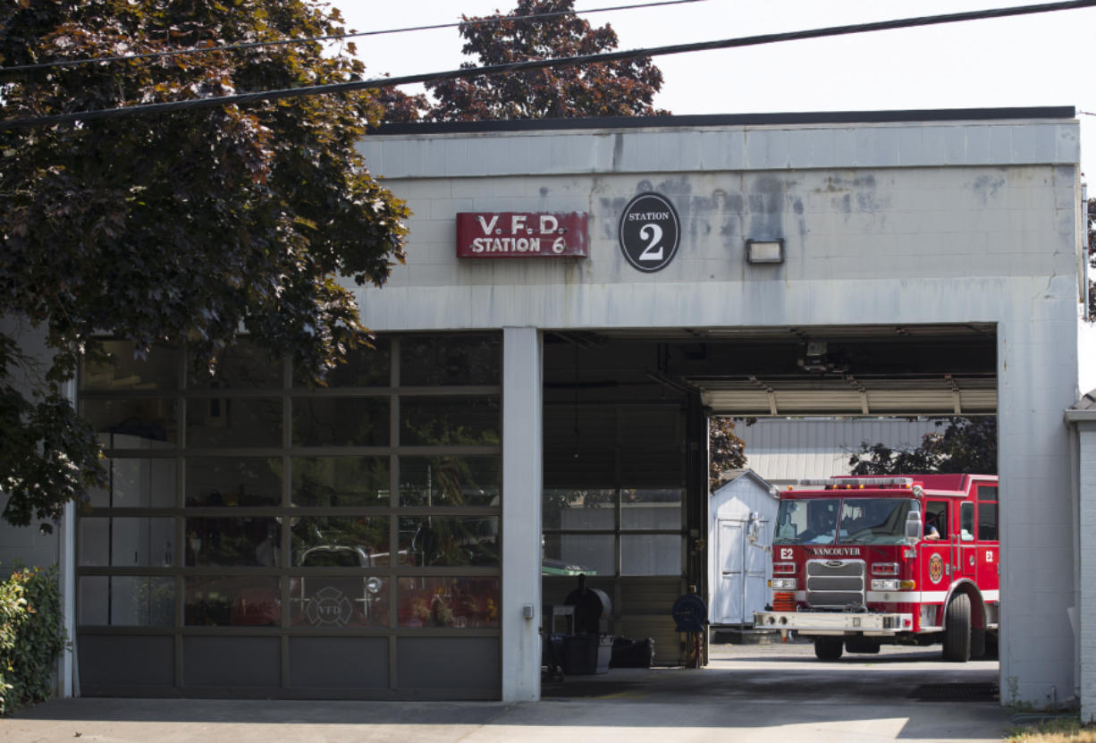 A fire truck arrives back at Vancouver Fire Department's Fire Station 2 in the Shumway neighborhood. The station is one of two slated to be sold at the end of the year, and neighbors wonder what could replace it.