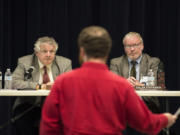 Energy Facility Site Evaluation Council members Bill Lynch, left, and Cullen Stephenson, right, listen as Ryan Rittenhouse of Friends of the Columbia Gorge speaks at Clark College during a permit hearing last November.