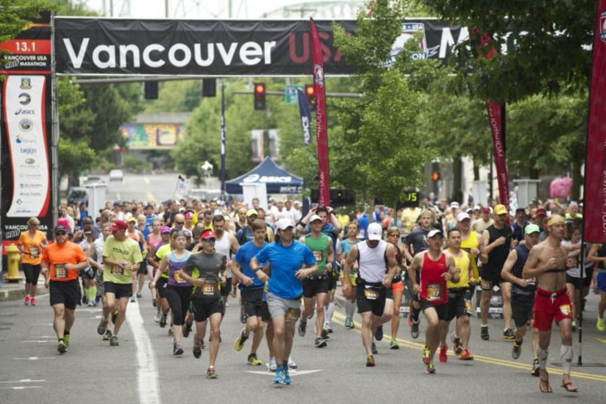 Runners leave the starting line for the Vancouver USA Marathon in downtown Vancouver. The Columbian files