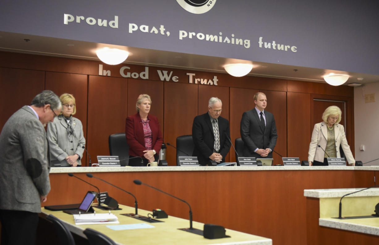 The Clark County Council observes a moment of silence before their meeting at the Public Service Building in Vancouver, Tuesday May 9, 2017.