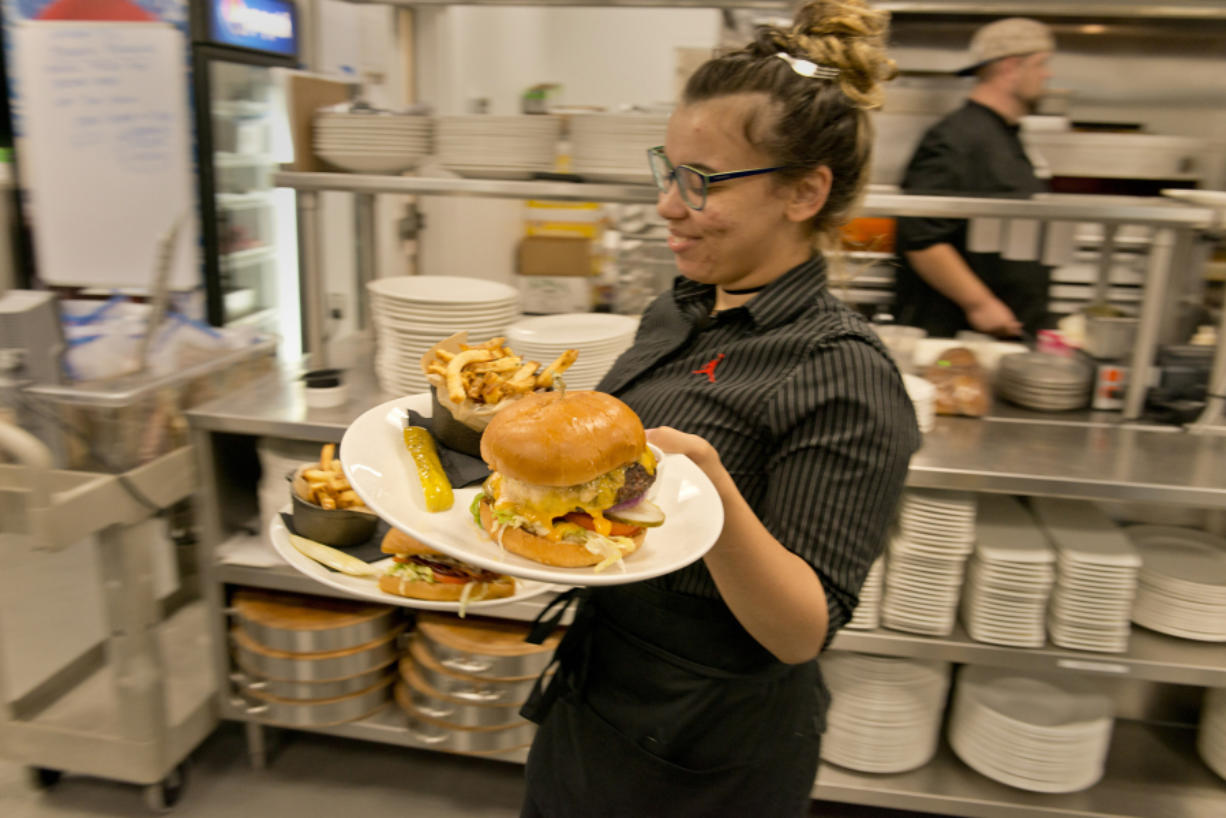 Kellie Tarquini, a server at Michael Jordan's Steak House at Ilani Casino Resort, plates and delivers a burger special one August weekend. The sector added 1,300 jobs in the past calendar year, good for 8.5 percent growth.